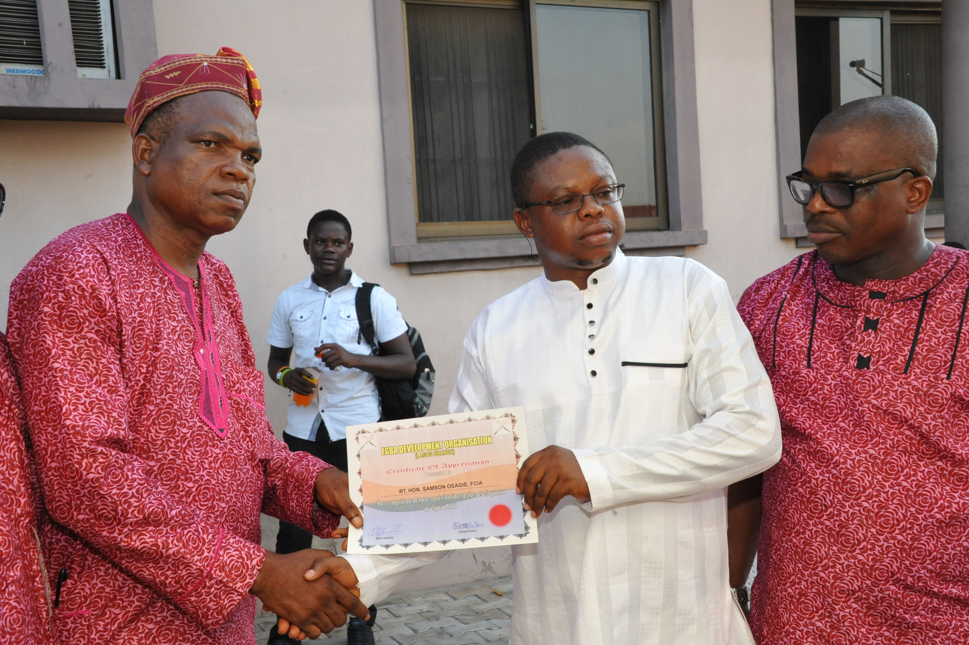 Dr. Okungbowa Osagie, (middle) receiving a special recognition award on behalf of Hon. Samson Osagie, from Mr. Victor Igbinoba Secretary of Egba Development Organisation, Lagos Branch, with them is Mr. Charles Igbinidu, the Public Relations Officer