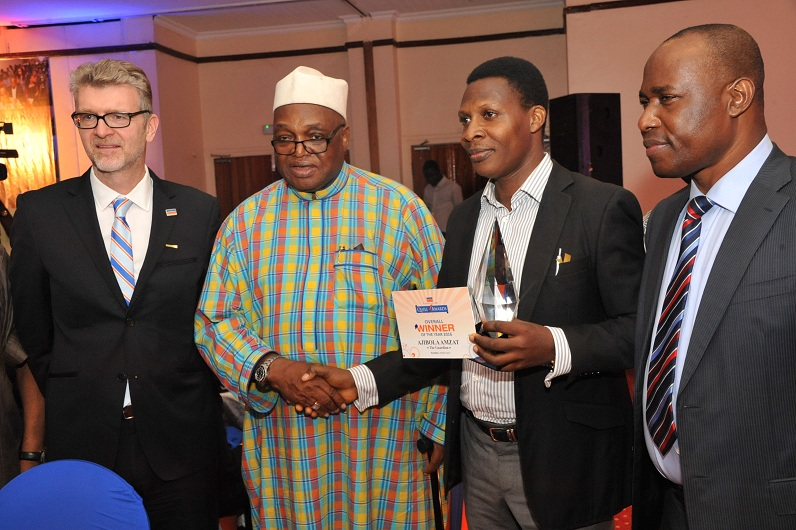 (L-R) Olivier Thiry, Managing Director, Promasidor Nigeria Limited; Ambassador Patrick Dele Cole, Chairman, Panel of Judges; Ajibola Amzat, overall winner; and Martins Oloja, former Editor/member Editorial Board, Guardian newspapers