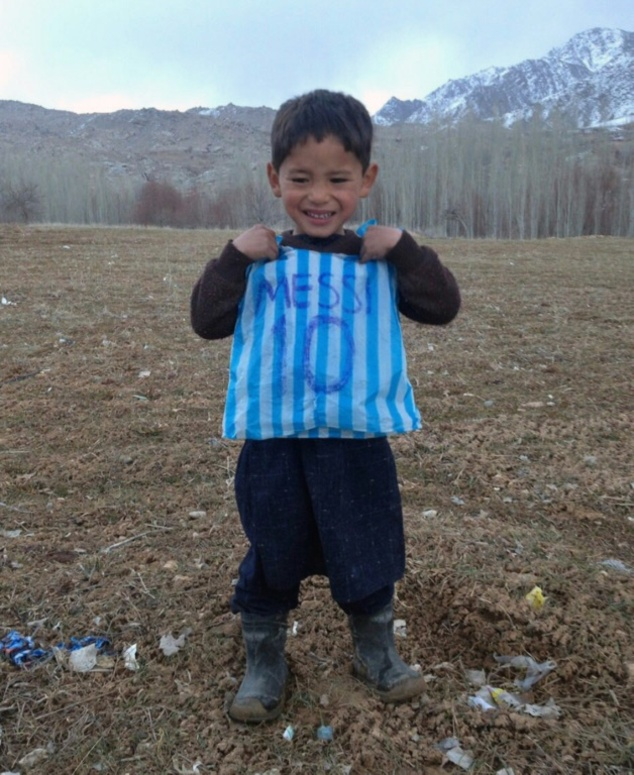 "Afghan boy Murtaza Ahmadi earned the nickname ""little Messi"" after pictures went viral of him wearing an improvised shirt made out of a plastic bag"