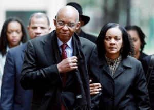 November 2009 - Former Congressman William Jefferson (D-LA) walks with his wife Andrea Jefferson as he arrives at US District Court for his sentencing hearing in Alexandria, Virginia. (Wilson/Getty).